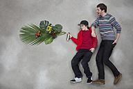 Boy spraying plant through spray can - BAEF000252