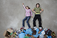 Boy and girl on stack of garbage - BAEF000270