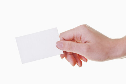 Human hand holding business card, close-up - TSF000202
