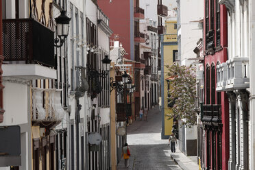 Spain, Canary Islands, La Palma, People walking on street - SIE000746