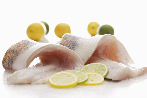 Pike perch with lime slices on white background - CSF014880