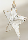 Close-up of wooden star christmas ornament - WBF000843