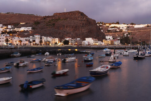 Spain, Canary Islands, La Gomera, Playa de Santiago, View of buildings at dusk - SIEF000859