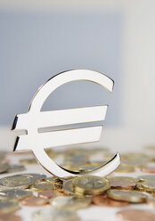 Close up of euro sign with euro coins - WBF001019