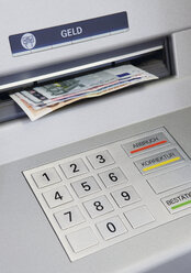 Close up of cash machine with notes - WBF001025
