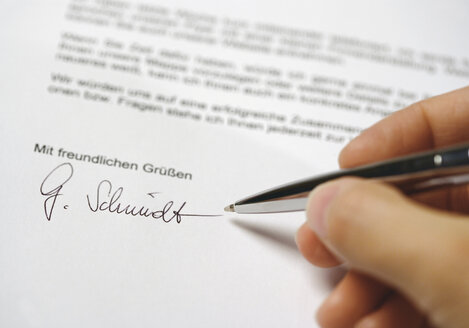 Close up of man hand signing letter - WBF001217