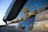 Germany, Bavaria, Munich, View of BMW headquarters and museum reflecting in glasses of BMW welt - PS000443