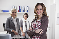 Germany, Bavaria, Munich, Businesswomen in office, smiling, portrait - RBF000509