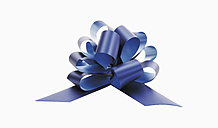 Gift ribbon against white background, close-up - WBF001069