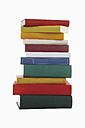 Stack of books against white background - WBF001094