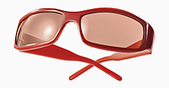 Red sunglasses against white background, close up - WBF001152