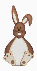 Wooden rabbit figurine against white background, close up - WBF001196