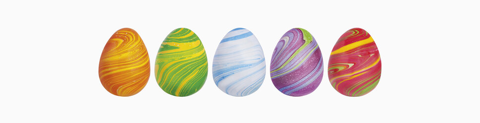 Variety of easter eggs against white background, close up - WBF001199