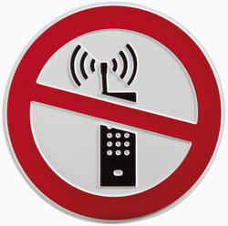 Cell phone ban sign against white background, close up - WBF001211