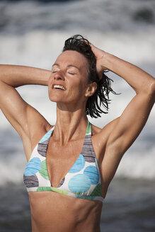 Greece, Crete, Mature woman in bikini - AKF000337