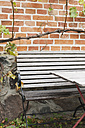 Germany, Kratzeburg, Empty bench and table at garden near country house - WESTF016587