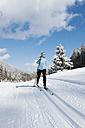 Germany, Bavaria, Aschermoos, Senior woman doing cross-country skiing - MIRF000102