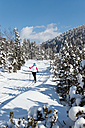 Germany, Bavaria, Aschermoos, Senior woman doing cross-country skiing - MIRF000108