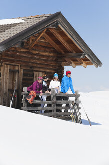 Italy, Trentino-Alto Adige, Alto Adige, Bolzano, Seiser Alm, People standing outside ski resort near railings - MIRF000114
