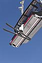 Italy, Trentino-Alto Adige, Alto Adige, Bolzano, Seiser Alm, Senior woman travelling in ski lift - MIRF000126