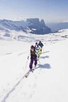 Italy, Trentino-Alto Adige, Alto Adige, Bolzano, Seiser Alm, Group of people on ski tour - MIRF000132