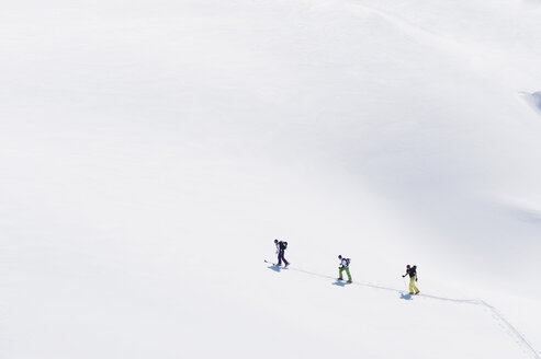 Italy, Trentino-Alto Adige, Alto Adige, Bolzano, Seiser Alm, Group of people on ski tour - MIRF000135