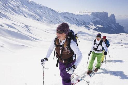 Italy, Trentino-Alto Adige, Alto Adige, Bolzano, Seiser Alm, Group of people on ski tour - MIRF000141