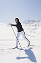 Italy, Trentino-Alto Adige, Alto Adige, Bolzano, Seiser Alm, Mid adult woman doing cross-country skiing - MIRF000159