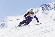 Italy, Trentino-Alto Adige, Alto Adige, Bolzano, Seiser Alm, Mid adult woman skiing - MIRF000165