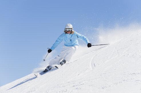 Italy, Trentino-Alto Adige, Alto Adige, Bolzano, Seiser Alm, Young woman skiing - MIRF000174
