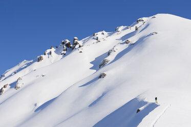 Italy, Trentino-Alto Adige, Alto Adige, Bolzano, Seiser Alm, Mid adult man skiing on mountain - MIRF000177