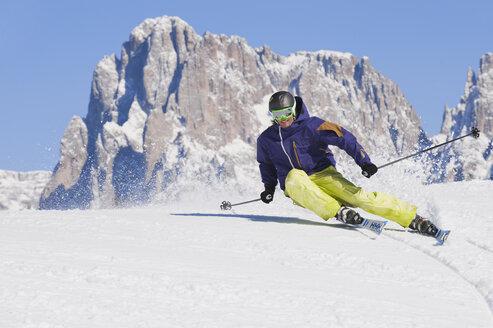 Italy, Trentino-Alto Adige, Alto Adige, Bolzano, Seiser Alm, Mid adult man on ski tour - MIRF000180