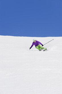 Italy, Trentino-Alto Adige, Alto Adige, Bolzano, Seiser Alm, Young woman skiing - MIRF000189