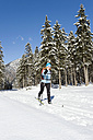 Germany, Bavaria, Senior woman doing cross-country skiing on winter landscape - MIRF000210