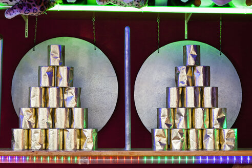 Germany, Bavaria, Munich, Pyramid of tin cans in fairground booth at oktoberfest - FOF003320