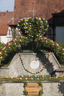 Germany, Bavaria, Franconia, Franconian Switzerland, Kirchehrenbach, View of decorated easter well - SIE001401