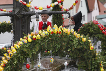 Germany, Bavaria, Franconia, Franconian Switzerland, Muggendorf, View of decorated easter well - SIE001426