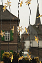 Germany, Cologne, Close up of illuminated stars as christmas window decoration - GWF001451