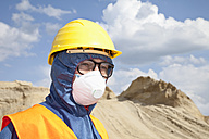 Germany, Bavaria, Man in protective workwear at sand dune - MAEF003320