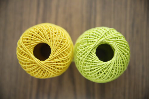 Germany, Close up of two balls of cord - TCF001495