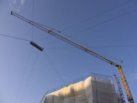 Germany, Munich, View of building crane against blue sky - LFF000270