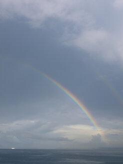 Southern Italy, Amalfi Coast, Piano di Sorrento, View of beautiful rainbow in sea at dawn - LFF000290