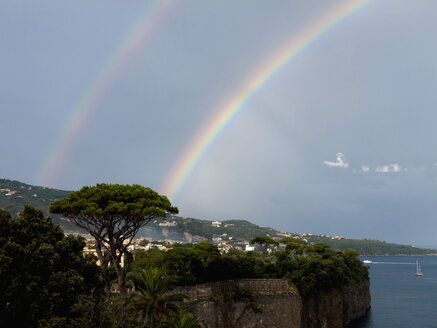 Southern Italy, Amalfi Coast, Piano di Sorrento, View of beautiful rainbow in sea with cliff in foreground - LFF000293