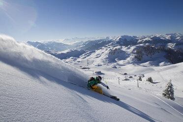 Austria, Tyrol, Kitzbühel, Mature man doing freestyle skiing - FFF001157
