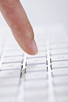 Close up of woman's finger pointing at keyboard - TSF000247