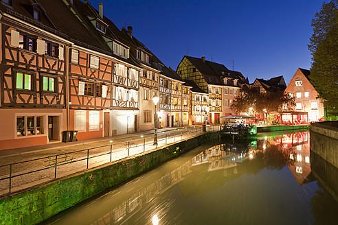 France, Alsace, Colmar, Krutenau, Quai de la Poissonnerie, View of La Petite Venise quarters with restaurant near Lauch river at night - WDF000890