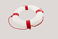 Close up of lifesaver against white background - WESTF016745