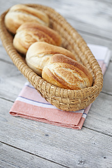Germany, Close up of bread rolls in bread basket on napkin - MAEF003357
