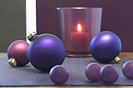 Close up of christmas bauble and tealight candle - ASF004357