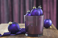 Close up of christmas baubles in glass - ASF004363